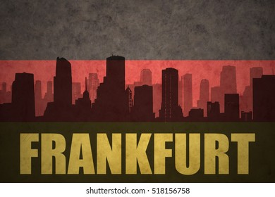 abstract silhouette of the city with text Frankfurt at the vintage german flag background