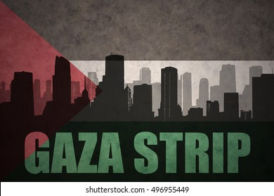 abstract silhouette of the city with text Gaza Strip at the vintage palestinian flag background