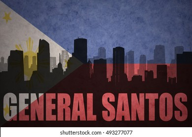 abstract silhouette of the city with text General Santos at the vintage philippines flag background