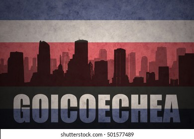 abstract silhouette of the city with text Goicoechea at the vintage costa rican flag background