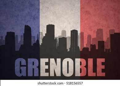 abstract silhouette of the city with text Grenoble at the vintage french flag background