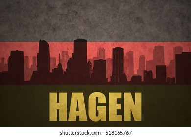abstract silhouette of the city with text Hagen at the vintage german flag background