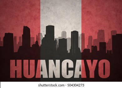 abstract silhouette of the city with text Huancayo at the vintage peruvian flag background