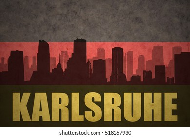 abstract silhouette of the city with text Karlsruhe at the vintage german flag background
