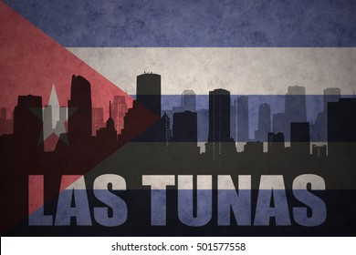 abstract silhouette of the city with text Las Tunas at the vintage cuban flag background