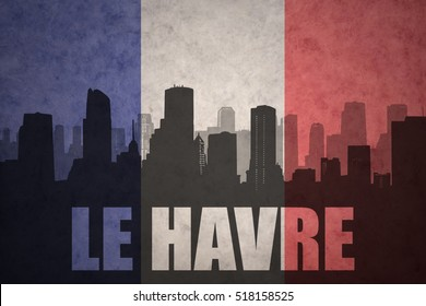 abstract silhouette of the city with text Le Havre at the vintage french flag background