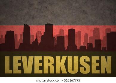 abstract silhouette of the city with text Leverkusen at the vintage german flag background