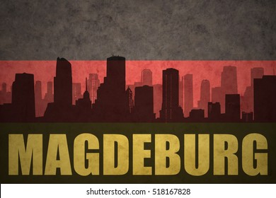 abstract silhouette of the city with text Magdeburg at the vintage german flag background