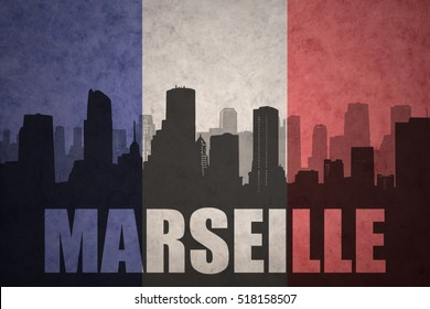 abstract silhouette of the city with text Marseille at the vintage french flag background