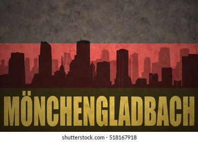 abstract silhouette of the city with text Monchengladbach at the vintage german flag background