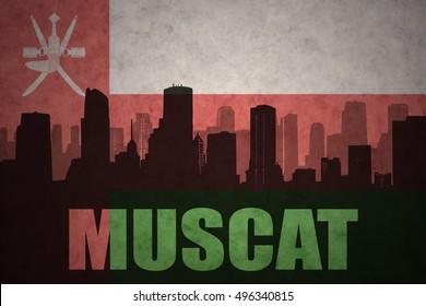 abstract silhouette of the city with text Muscat at the vintage oman flag background