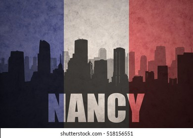 abstract silhouette of the city with text Nancy at the vintage french flag background