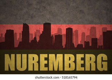 abstract silhouette of the city with text Nuremberg at the vintage german flag background
