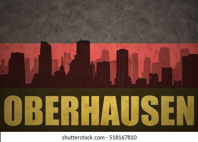 abstract silhouette of the city with text Oberhausen at the vintage german flag background