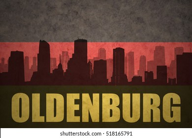 abstract silhouette of the city with text Oldenburg at the vintage german flag background