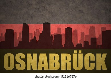 abstract silhouette of the city with text Osnabruck at the vintage german flag background