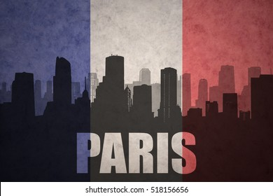abstract silhouette of the city with text Paris at the vintage french flag background
