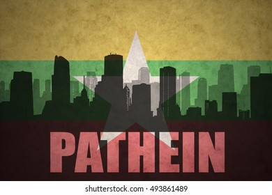 abstract silhouette of the city with text Pathein at the vintage myanmar flag background