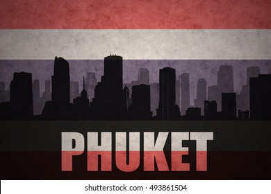 abstract silhouette of the city with text Phuket at the vintage thailand flag background