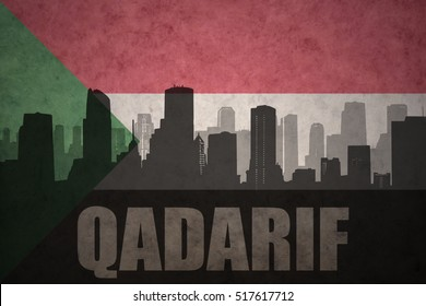 abstract silhouette of the city with text Qadarif at the vintage sudanese flag background