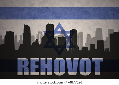 abstract silhouette of the city with text Rehovot at the vintage israel flag background