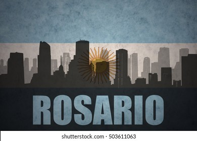 abstract silhouette of the city with text Rosario at the vintage argentinean flag background
