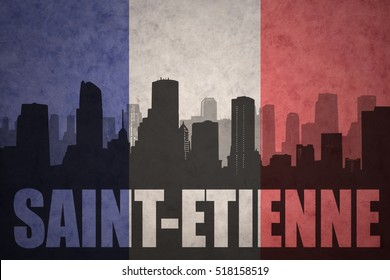 abstract silhouette of the city with text Saint-Etienne at the vintage french flag background