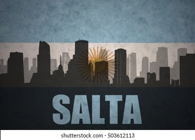 abstract silhouette of the city with text Salta at the vintage argentinean flag background