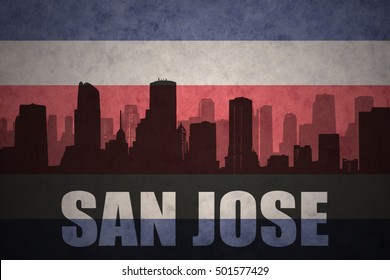 abstract silhouette of the city with text San Jose at the vintage costa rican flag background