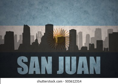 abstract silhouette of the city with text San Juan at the vintage argentinean flag background