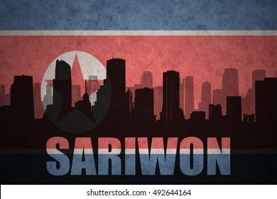 abstract silhouette of the city with text Sariwon at the vintage north korea flag background