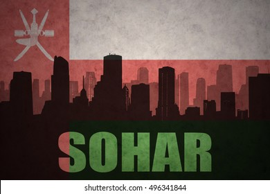 abstract silhouette of the city with text Sohar at the vintage oman flag background