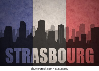 abstract silhouette of the city with text Strasbourg at the vintage french flag background