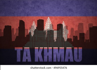 abstract silhouette of the city with text Ta Khmau at the vintage cambodian flag background