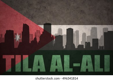 abstract silhouette of the city with text Tila al-Ali at the vintage jordan flag background