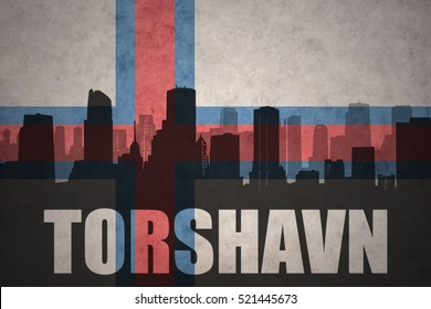 abstract silhouette of the city with text Torshavn at the vintage faroe islands flag background