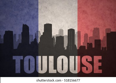 abstract silhouette of the city with text Toulouse at the vintage french flag background