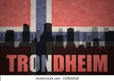 abstract silhouette of the city with text Trondheim at the vintage norwegian flag background