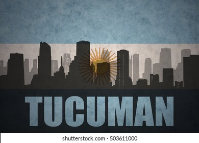 abstract silhouette of the city with text Tucuman at the vintage argentinean flag background