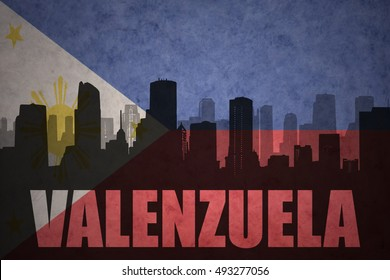 abstract silhouette of the city with text Valenzuela at the vintage philippines flag background