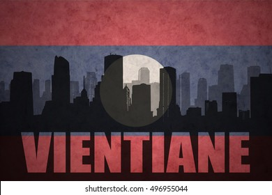 abstract silhouette of the city with text Vientiane at the vintage laotian flag background