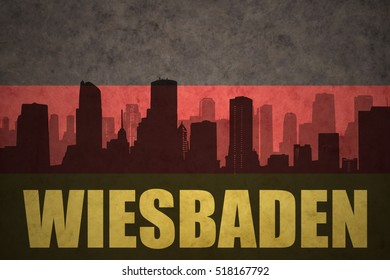 abstract silhouette of the city with text Wiesbaden at the vintage german flag background