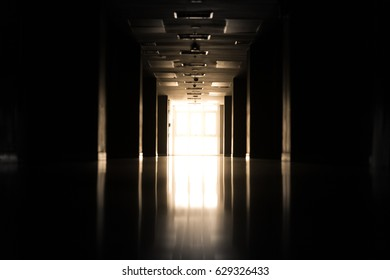 Abstract silhouette of empty corridor in building with sun light.