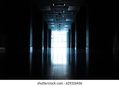 Abstract silhouette of empty corridor in building with blue light.