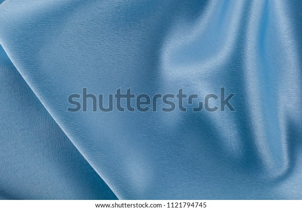 Abstract silk luxury background, piece of cloth, light blue cloth texture.