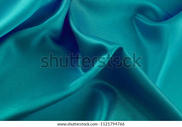 Abstract silk luxury background, piece of cloth, deep sea blue cloth texture