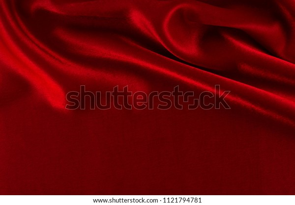 Abstract silk luxury background, piece of cloth, deep red cloth texture