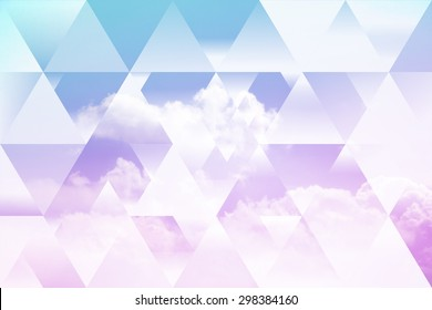 abstract sky geometric background with triangles, cumulus clouds. polygonal cloudscape backdrop