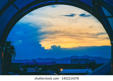 Abstract sky in sunset time with curved window frame.