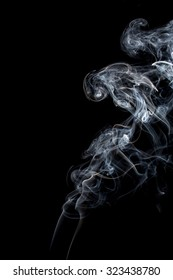 Abstract of smoke dance on a black background.